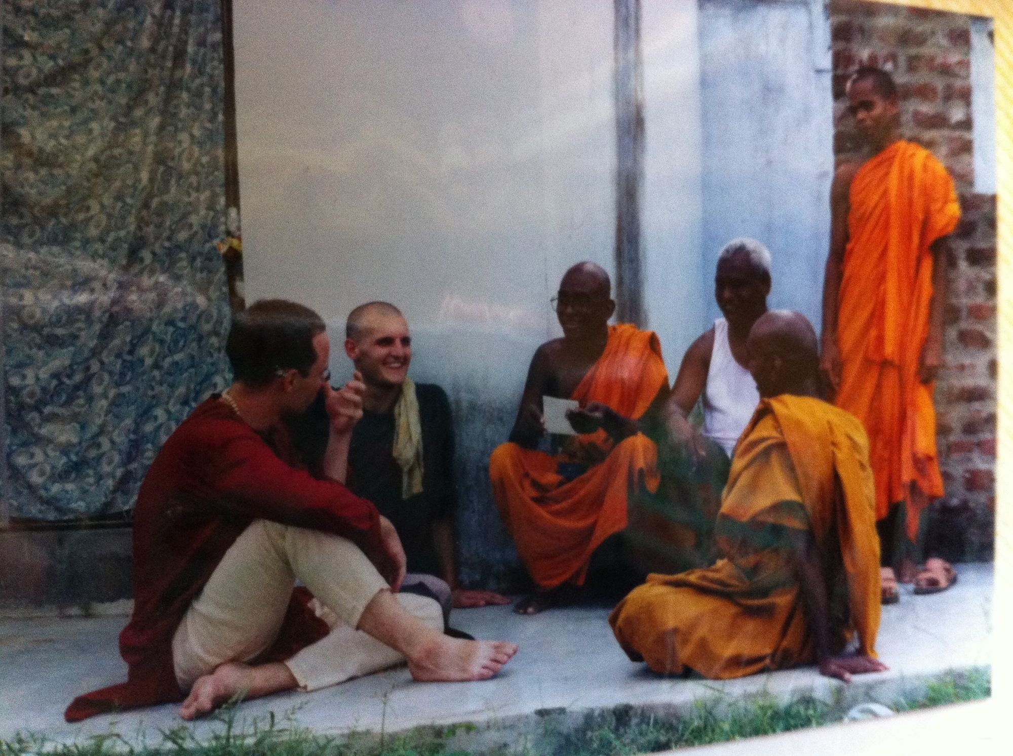 Image of the author with group of Buddhist monks.